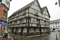 This twin gabled 15th-century timbered merchants house is now occupied by NatWest bank.