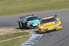 A Maserati MC12 competing against a Chevrolet Corvette C5-R