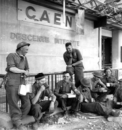 Stormont, Dundas and Glengarry Highlanders resting  at Caen station, July 1944.