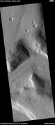 Wide view of flow moving down valley, as seen by HiRISE under HiWish program Location is Ismenius Lacus quadrangle.