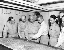 Geiger (third from left) and III MAC staff during the planning of Okinawa operation. From left to right: David R. Nimmer, Walter A. Wachtler, Geiger, Merwin H. Silverthorn, Sidney S. Wade, Francis B. Loomis Jr. and Gale T. Cummings.