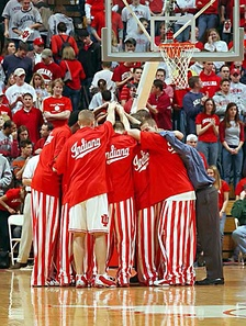 Players huddle before a game in their iconic candy striped pants