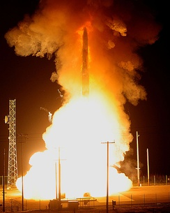 An unarmed Minuteman III ICBM shoots out of the silo during an operational test launch