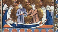 Medieval depiction of a royal body being laid in a coffin.