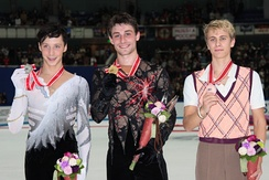 Joubert (center) with the other medalists at the 2009 NHK Trophy