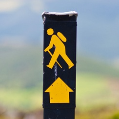 "The traditional ""walking man"" waymarker used to designate National Waymarked Trails in Ireland"