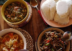 Nshima (top right corner) with three types of relish.