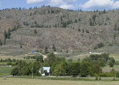 A farm and barren hills near Riverside, in north central Washington