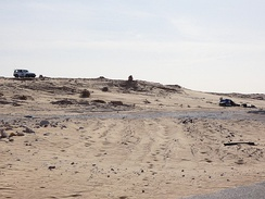 Left a car of MINURSO, right a post of the Frente polisario in 2017 in southern Western Sahara