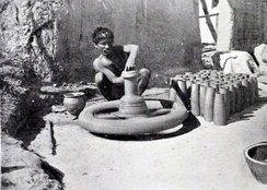 A potter with his pottery wheel, British Raj (1910)