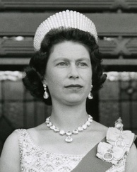 Elizabeth wearing the Coronation Earrings and matching necklace at the opening of the New Zealand parliament in 1963. She also wore the Kokoshnik Tiara.