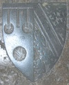 Escutcheon from monumental brass of Sir Peter Courtenay (d.1405), KG, Exeter Cathedral, Devon, showing: dexter: Or, three torteaux a label azure (Courtenay) impaling Azure, a bend argent cotised or between six lions rampant or (Bohun). This impaled shield shows the arms of his father (Hugh de Courtenay, 2nd Earl of Devon) impaling the paternal arms of his mother, Margaret de Bohun, the daughter of Humphrey de Bohun, 4th Earl of Hereford