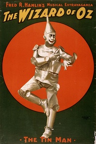 1903 poster of Dave Montgomery as the Tin Man in Hamlin's musical stage version.