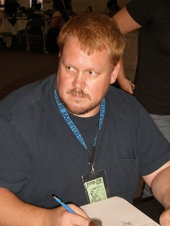 Hughes doing a convention sketch in May 2009