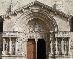 The Basilica of Saint-Trophime, Arles, France, has an elaborate sculptural scheme which includes Christ in Majesty, a frieze extending over the lintel and a gallery of sculptured figures.