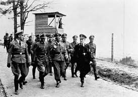 Kaltenbrunner (on the far left), Heinrich Himmler and August Eigruber inspect Mauthausen concentration camp in 1941, in the company of camp commander Franz Ziereis.