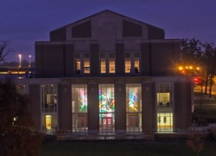 The Music Instruction Building at night, with Stephen Knapp's First Symphony in view.
