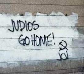 "Graffiti on the wall of the Israeli Embassy in Caracas, saying ""Jews (Judios) go home!"" and signed by the JCV."