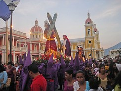 Lent celebrants carrying out a street procession during Holy Week, in Granada, Nicaragua. The violet color is often associated with penance and detachment. Similar Christian penitential practice is seen in other Christian countries, sometimes associated with mortification of the flesh.[18]