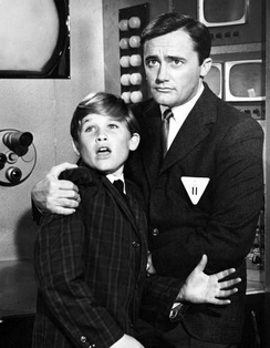 Russell with Robert Vaughn in a 1964 episode of The Man from U.N.C.L.E.