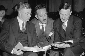 J. Warren Madden (left) goes over testimony with Charles Fahy (right) and Nathan Witt prior to a U.S. Senate Commerce Committee hearing on December 13, 1937.