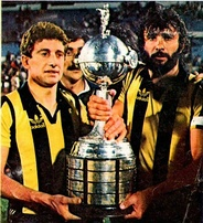 Fernando Morena (left) and Walter Olivera holding the trophy won in 1982