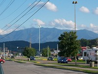 Pigeon Forge with Mount Le Conte in the background.