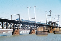Amtrak Acela Express crosses the Susquehanna River in Maryland on a bridge built by the PRR in 1906.