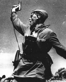 A Soviet junior political officer (Politruk) urges Soviet troops forward against German positions (12 July 1942)