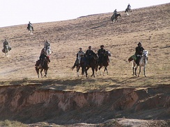 U.S. Special Forces and Combat Controllers on horseback with the Northern Alliance of Afghanistan, which frequently used horses as military transport.