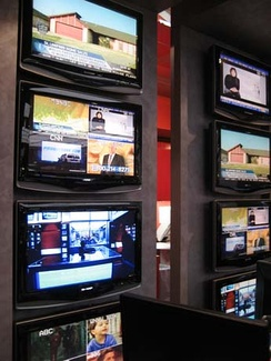 The monitors of the MSNBC newsroom are tuned into various global channels.