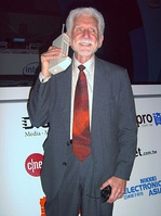 Martin Cooper photographed in 2007 with his 1973 handheld mobile phone prototype