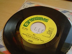 A standard wide-hole 7-inch vinyl record from 1978 on its sleeve.