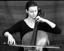 A young cellist performing
