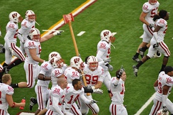 Badgers celebrate their win by carrying Paul Bunyan's Axe around Camp Randall after the 2009 game.