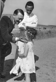 Goebbels and his daughter Helga with Adolf Hitler