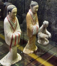 A female servant and male advisor dressed in silk robes, ceramic figurines from the Western Han era