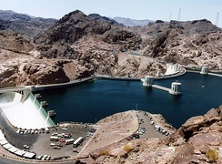 Water enters the Arizona spillway (left) during the 1983 floods. Lake Mead water level was 1,225.6 ft (373.6 m)