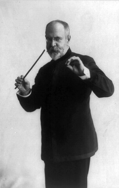 John Philip Sousa conducting with a baton (1911).