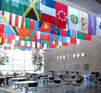 Flags represent the home countries and nationalities of currently attending students.