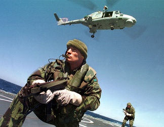 A Portuguese Marine (fuzileiros) team conducts a boarding exercise, under the coverage of a Navy's Super Lynx helicopter, in 1998.