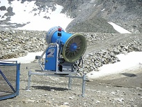 A rear view of a snow cannon with its fan showing