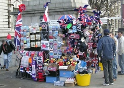 Sellers of souvenirs are typically located in high traffic areas such as this London souvenir stand situated near a railway station on a busy street corner