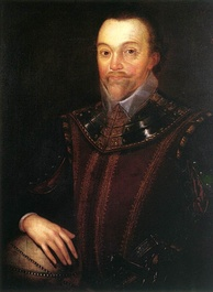 Man with high forehead and short pointed beard, in dark clothing which incorporates a shining leather or metallic collar. His right hand is resting on a globe of the world.
