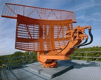 ASR-8 airport surveillance radar antenna.  It rotates once every 4.8 seconds.  The rectangular antenna on top is the secondary radar.
