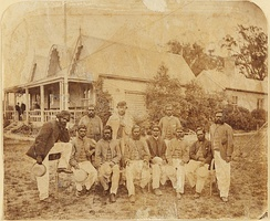 Aboriginal cricket team with captain-coach Tom Wills, December 1866. In the background is the original MCC pavilion, built in 1854.
