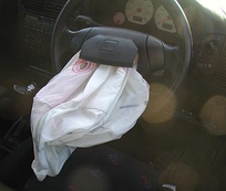 A deflated airbag on a steering wheel after a traffic accident