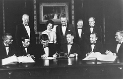 Schirra (sitting 3rd from left), signing a commemorative document, with his Apollo 7 crewmates, Apollo 8 crew, Charles Lindbergh, First Lady Bird Johnson, President Johnson, NASA Administrator Webb and Vice President Humphrey (1968)