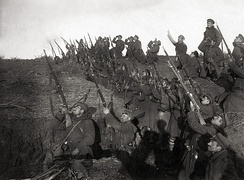 Bulgarian soldiers in a trench, preparing to fire against an incoming airplane.