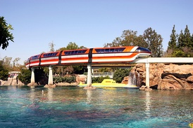 The Submarine Lagoon at Tomorrowland. Monorail Orange is passing over a submarine.
